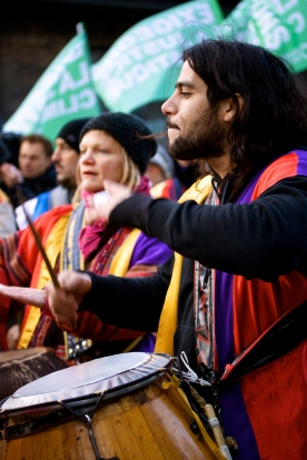 An activist keeps the beat during a march at COP15.